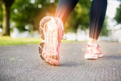 Walking with heel pain in foot.