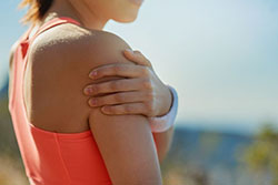 Female athlete with shoulder pain