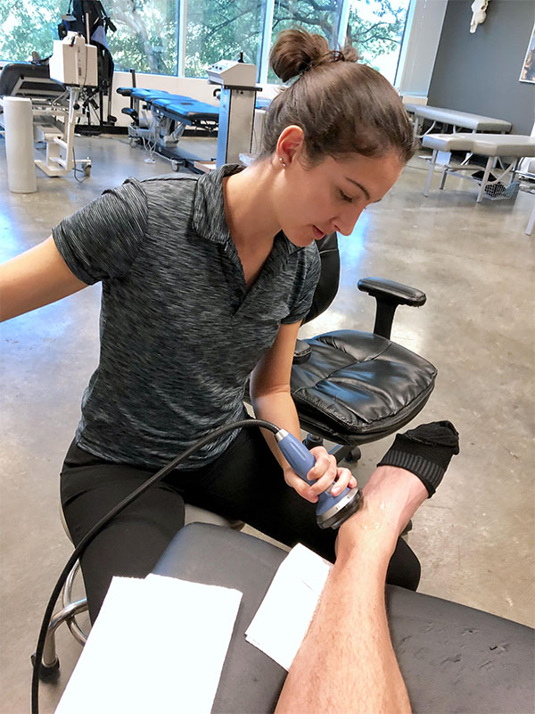 Dr. Ashley uses Acoustic Compression Therapy (ACT) to treat an ankle injury.