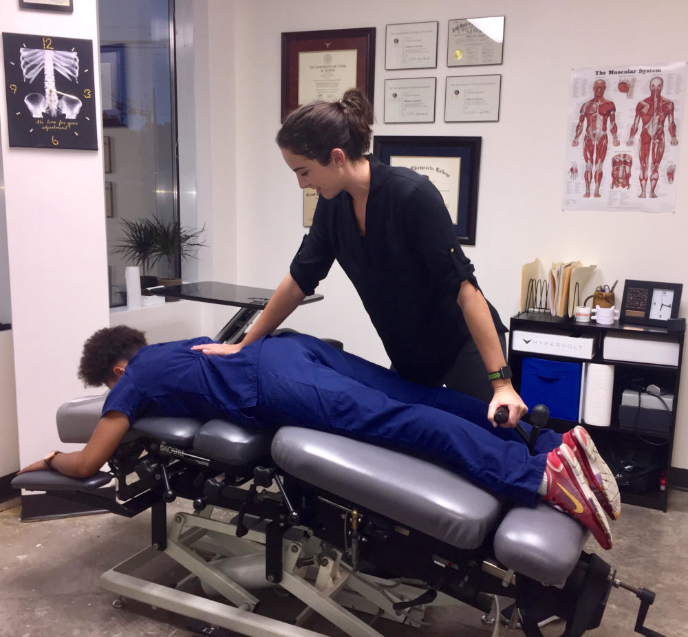 Dr. Ashley performing flexion distraction on a patient to relieve low back pain.