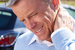 man with whiplash pain