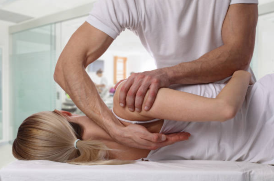 Chiropractor using one of the five common chiropractic adjustment techniques to treat patient