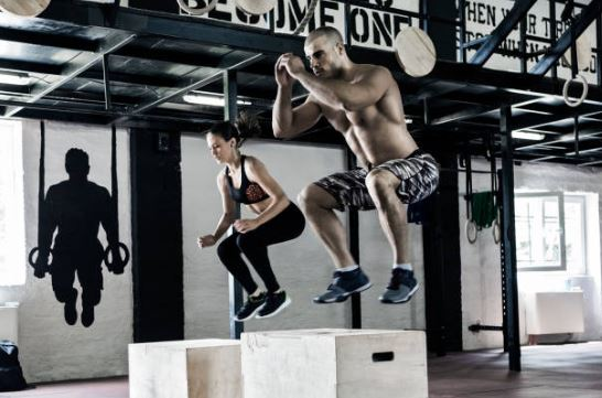 Man and woman working out at crossfit gym in Austin, Texas