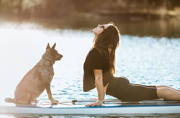 Girl doing yoga with dog in Austin, Texas