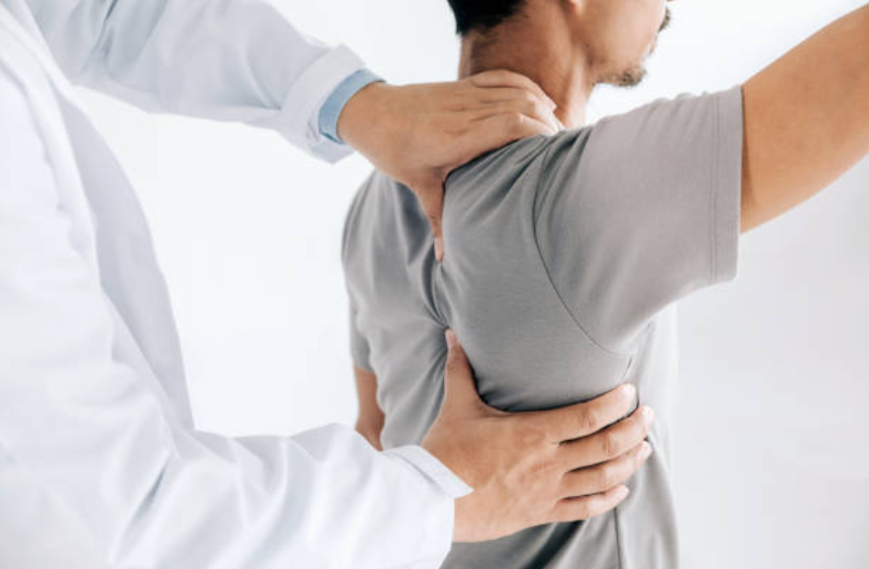 chiropractor performing spinal manipulation on patient